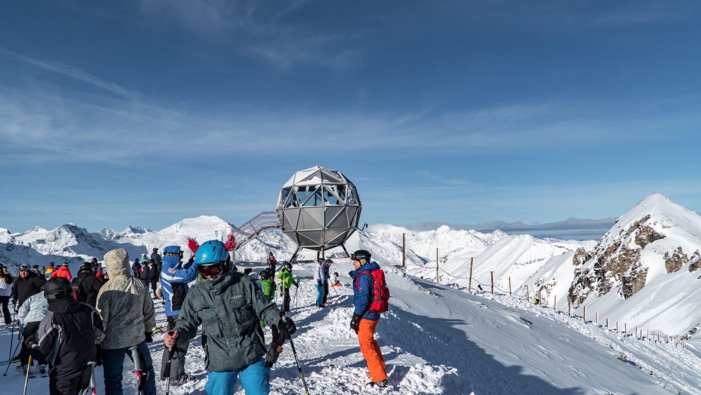 Wintersportler am Gipfel in Sportgastein.