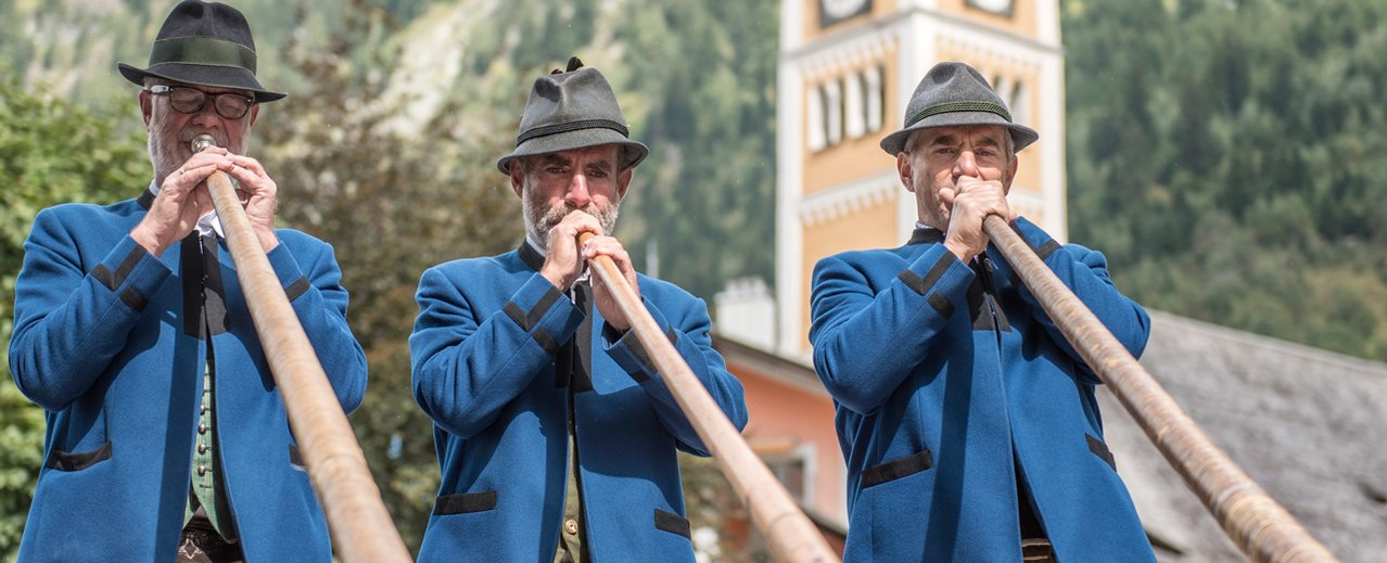 Alpenhorn players in folk costume